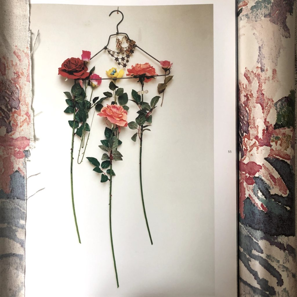 Tim Walker image of flowers on a coat hanger